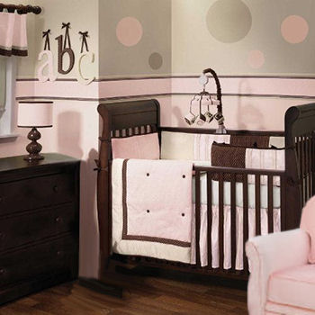 Sophisticated pink and chocolate brown crib bedding set for a baby girl nursery