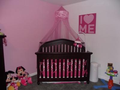 A baby girl nursery room with gray wall paint apple custom crib bedding set with red accent colors