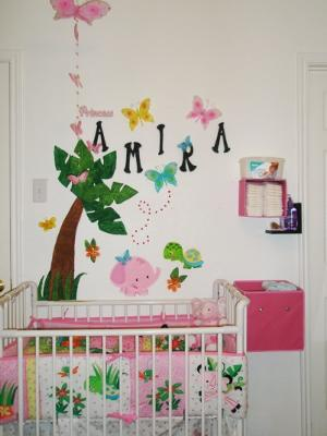 Small pink baby girls rainforest nursery theme design and decorating ideas.