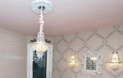 Elegant pink crystal nursery chandelier in a baby girl rococo princess nursery theme room