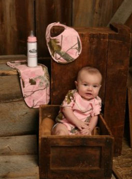 Pink camo baby clothes for a girl with camouflage bib onesie and booties to make a complete outfit set