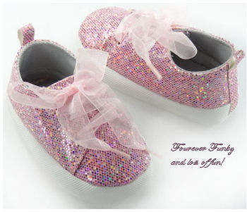 Baby shoes covered in pink sequins for baby girls