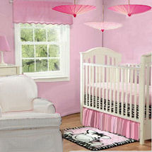 Pink girl zebra baby nursery theme room decorated in an umbrella theme