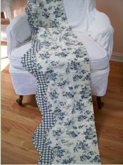 Black and white French toile window valance with a plaid border