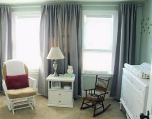Gender neutral nursery room decorated with polka dots for a baby boy