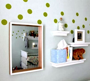 Gender neutral nursery room decorated with green vinyl polka dots wall decals for a baby boy