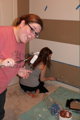 Painting the baby nursery wall in brown and white horizontal stripes was one of the best ideas ever
