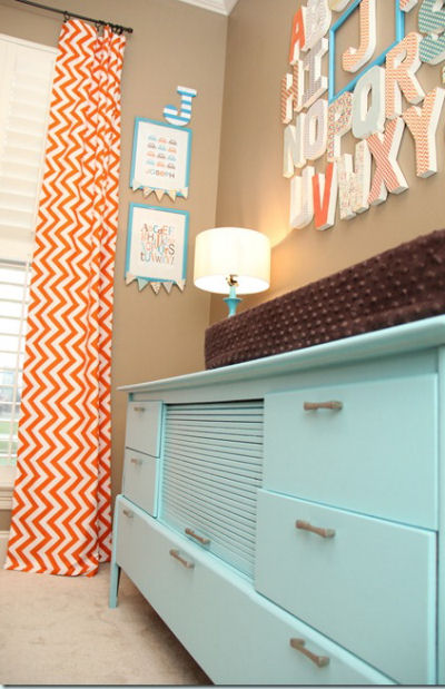 Vintage retro dresser painted aqua blue in a baby boy orange and blue owl nursery
