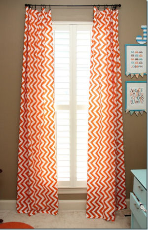 Orange and white chevon stripes baby nursery curtains in floor length panels