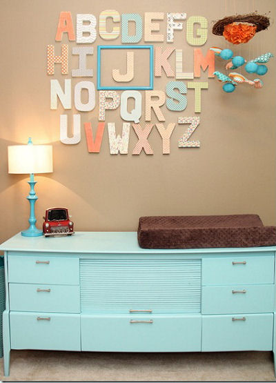 Wooden alphabet wall letters and framed baby initial in a boy nursery