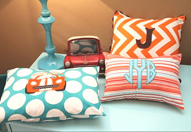 Personalized initial and muscle car pillows for a baby boy's car aqua blue and orange themed nursery