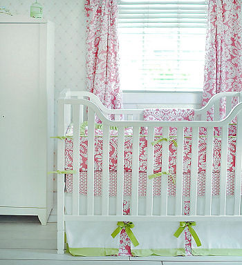 Elegant pink and white damask baby crib bedding with apple green accents for a baby girl
