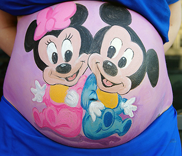 Fun Mickey and Minnie Mouse Disney cartoon character pregnancy belly painting idea for twins baby boy and girl