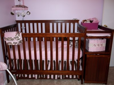 Our baby girl's crib and elegant pink and brown damask pattern baby bedding set