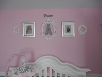 An arrangement of wall decorations in a baby girl's pretty pink princess nursery