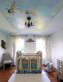 Baby blue boy nursery design with a cherub ceiling mural