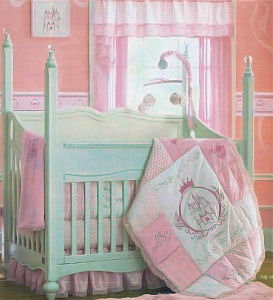Elegant but affordable Disney princess bed with antique ivory and pink baby bedding set in a storybook fairy nursery.