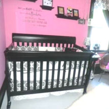 A black and white damask baby girl nursery crib bedding set is pretty with a pink wall paint color