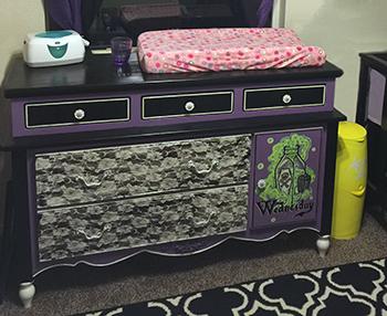cutesy purple and black punk rock nursery ideas for a baby