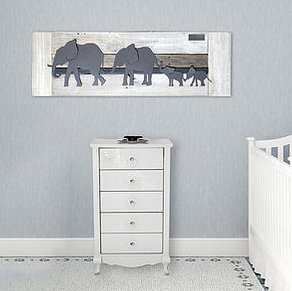 Reclaimed wood art for a baby elephant nursery theme.