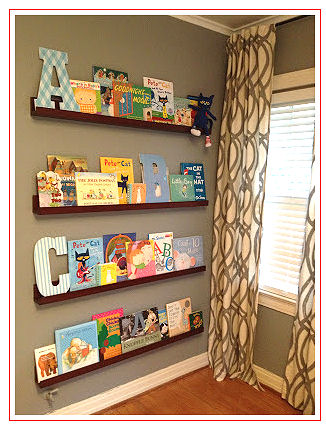 Floating shelves filled with books decorate the walls in a modern nursery
