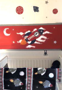 Moon stars planets and rocket ship vinyl wall art with the baby boy's name included in the decals
