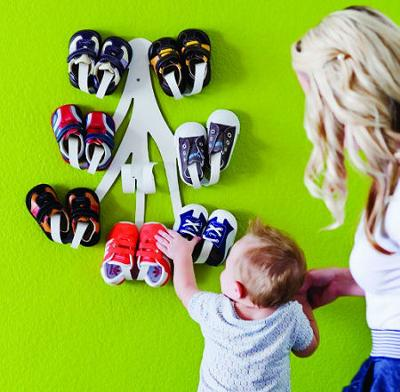 The Boon Baby Shoe Rack looks amazing on the nursery wall!  All the more reason not to hold back on buying as many cute booties as mom wants!