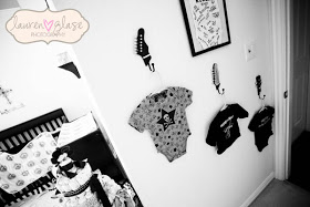 Rock star baby onesies used as nursery room wall decorations