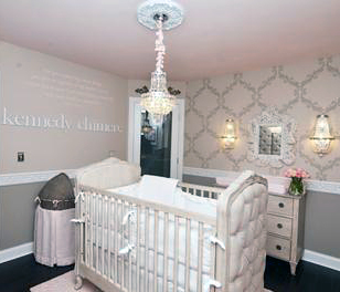 Elegant baby crib with tufted upholstery in a baby girl nursery room