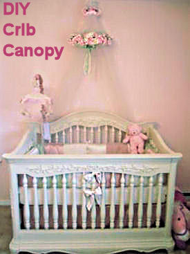 Antique white and pink princess rose baby bedding set with a homemade crib canopy decorated with a wreath of silk flowers and a jeweled tiara