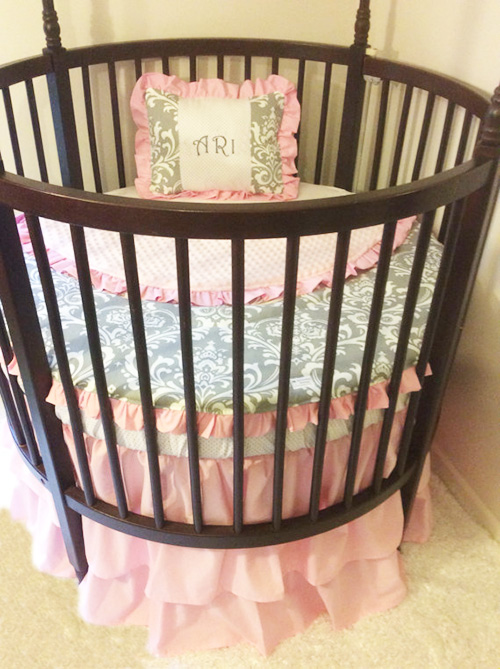 Personalized round pink grey and white damask baby crib bedding set in for a baby girl nursery room