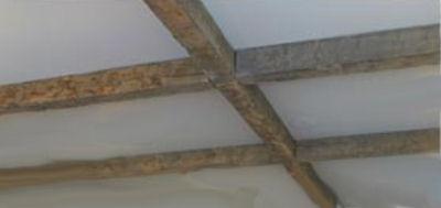 Exposed log beams ceiling decor in a rustic baby nursery room