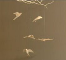 Wooden baby nursery mobile suspended from wood branches and twigs