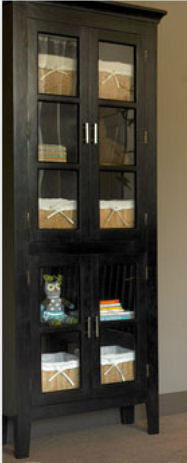 Rustic antique walnut glass front cabinet holding organizer baskets can be used as baby nursery storage