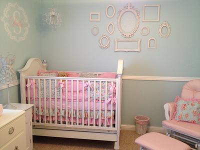 Elegant vintage style crib and DIY wall arrangment in a baby girl shabby chic nursery design using a variety of antique  picture frames as wall decor