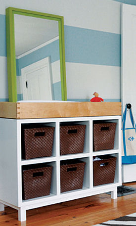 Modern white baby diaper changing table area in a blue and white nursery for a baby boy
