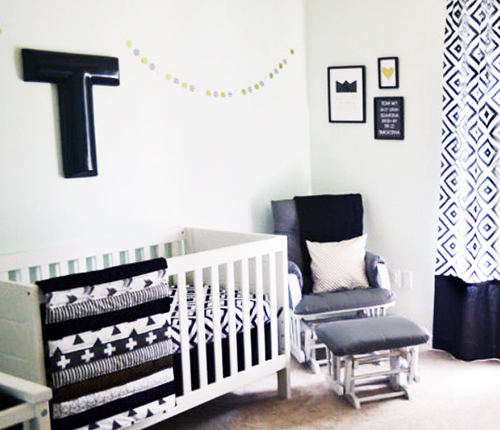 Modern black and white neutral baby nursery decorating ideas with crosses triangles geometric patterns
