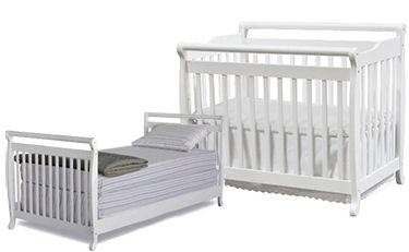 White foldable convertible baby crib perfect for a small nursery room