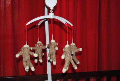 Homemade sock monkey baby crib mobile made to match a custom nursery bedding set
