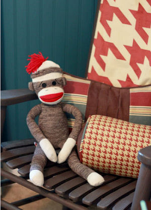Bright brick red gray and ivory white sock monkey baby nursery crib bedding set for a boy or girl room decor