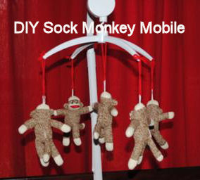 DIY sock monkey baby crib mobile for a nursery made with a kit
