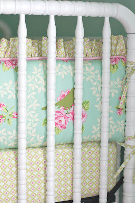 Custom floral baby girl crib bedding set for an aqua and pink nursery homemade by her talented grandmother