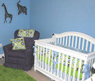Baby blue boy nursery room with polka dots and jungle animals
