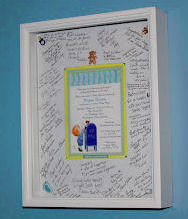 Framed baby boy shower invitation with autographs and wishes from the guests