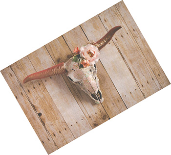 Cow skull wall decor with floral arrangement made of silk flowers