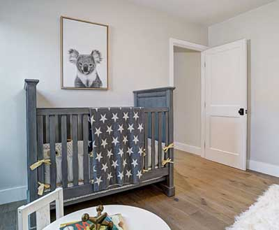 Neutral Koala bear baby nursery with star crib quilt