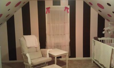 Pink and chocolate brown stripes on our baby girl's nursery wall painted by my husband.