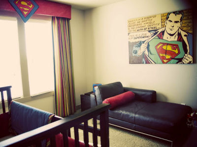 Cozy resting spot in the baby's super hero nursery
