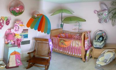 Surfer Girl Nursery Theme w pink and orange surf baby bedding and decor.