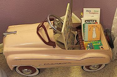 vintage pink baby girl pedal car bookshelf nursery decor
